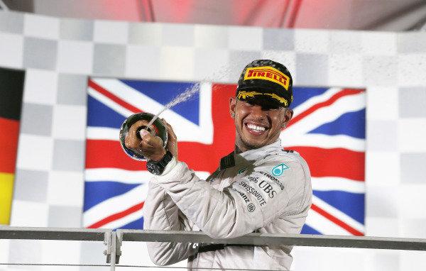 Marina Bay Circuit, Singapore. Sunday 21 September 2014. Lewis Hamilton, Mercedes AMG, 1st Position, sprays Champagne on the podium. World Copyright: Steven Tee/LAT Photographic. ref: Digital Image _X0W8051