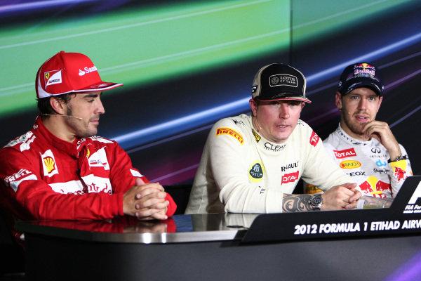 (L to R): Fernando Alonso (ESP) Ferrari, Kimi Raikkonen (FIN) Lotus F1 and Sebastian Vettel (GER) Red Bull Racing in the Press Conference. Formula One World Championship, Rd18, Abu Dhabi Grand Prix, Race, Yas Marina Circuit, Abu Dhabi, UAE, Sunday 4 November 2012.
