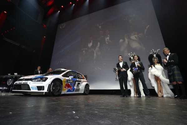 2013 FIA Gala Dinner and Awards. Paris, France. Friday 6th December 2013. World Rally Champions Sebastien Ogier and Julien Ingrassia on stage with their VW Polo WRC. World Copyright & Mandatory Credit: FIA. ref: Digital Image 11243653503_7da7ca48ed_o