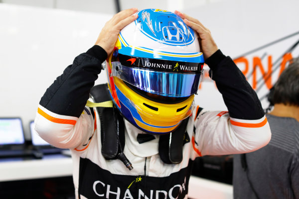 Suzuka Circuit, Japan. Friday 06 October 2017. Fernando Alonso, McLaren, puts on his helmet in the garage. World Copyright: Steven Tee/LAT Images  ref: Digital Image _O3I5748