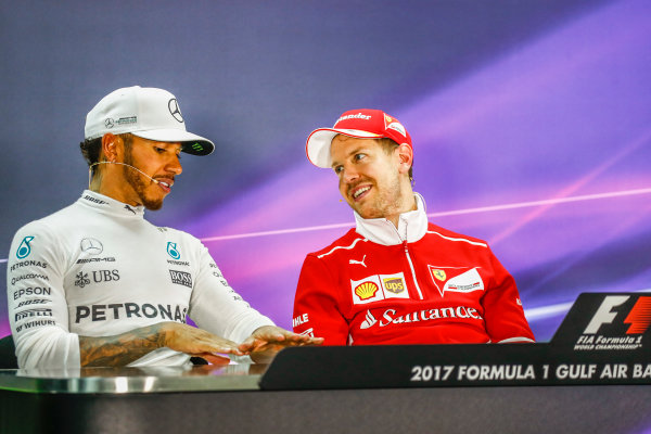 Bahrain International Circuit, Sakhir, Bahrain.  Sunday 16 April 2017. All smiles between Lewis Hamilton, Mercedes AMG, 2nd Position, and Sebastian Vettel, Ferrari, 1st Position, in the Press Conference. World Copyright: Sam Bloxham/LAT Images ref: Digital Image _W6I3413