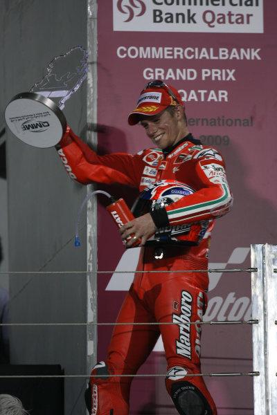 Qatar, Losail International Circuit.10th - 13th April 2009.Casey Stoner Marlboro Ducati Team celebrates on the podium.World Copyright: Martin Heath/LAT Photographicref: Digital Image BPI_Moto 7o63