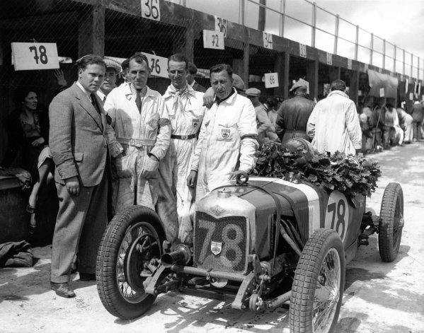 Nurburgring, Germany. 19th July 1931.Dudley Froy (second from the right), Riley 9, wins the 1100cc race held simultaneously with the German Grand Prix.World Copyright: LAT Photographic.Ref: Autocar Glass Plate B6840