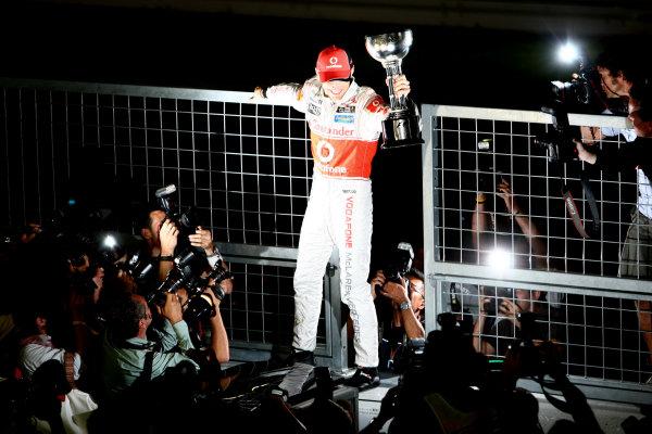 Suzuka Circuit, Suzuka, Japan.9th October 2011.Jenson Button, McLaren MP4-26 Mercedes, 1st position, celebrates with his trophy. Portrait. World Copyright: Andy Hone/LAT Photographicref: Digital Image CSP25845