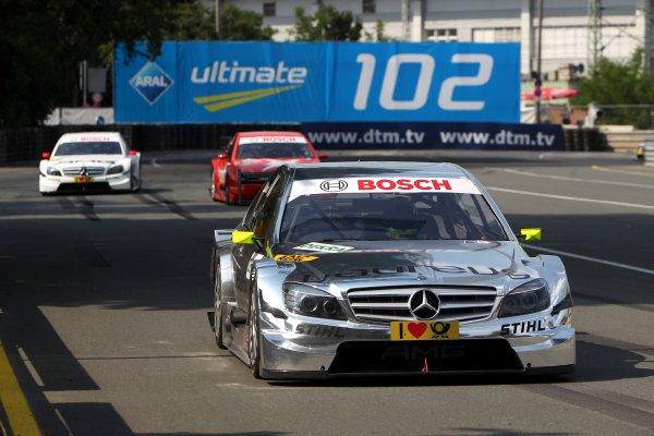 Ralf Schumacher (GER), Laureus AMG Mercedes C-Klasse (2009) takes pole position.DTM, Rd4, Norisring, Nuremberg, Germany. 2-4 July 2010 World Copyright: LAT PhotographicRef: Digital Image dne1003jy78