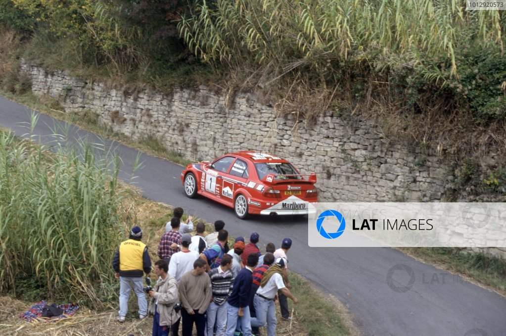 1999 World Rally Championship.Sanremo Rally, Italy. 11-13 October 1999.Tommi Makinen/Risto Mannisenmaki (Mitsubishi Lancer Evo6), 1st position.World Copyright: LAT PhotographicRef: 35mm transparency 99RALLY12
