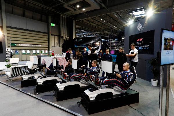 Autosport International Exhibition. National Exhibition Centre, Birmingham, UK. Thursday 11th January 2018. Drivers try the Bahrain International Circuit simulators.World Copyright: Glenn Dunbar/LAT Images Ref: _31I1980