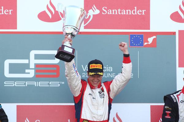 2012 GP3 Series, Round 3.Valencia, Spain. 24th June 2012. Sunday Race 2. Patric Niederhauser (SUI, Jenzer Motorsport) celebrates on the podium. Portrait. World Copyright:  Daniel Kalisz/LAT Photographic Ref: Digital Image IMG_2110