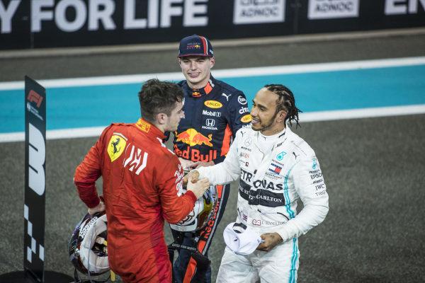 Charles Leclerc, Ferrari, 3rd position, congratulates Lewis Hamilton, Mercedes AMG F1, 1st position, after the race