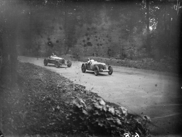 Percy Maclure, Riley 2000/6, leads Raymond Sommer, Alfa Romeo Tipo B/P3.