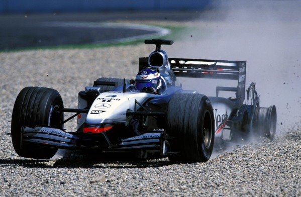 Kimi Raikkonen (FIN) McLaren Mercedes MP4/17 lost time when a tyre exploded. Formula One World Championship, Rd12, German Grand Prix, Hockenheim, Germany. 28 July 2002. BEST IMAGE