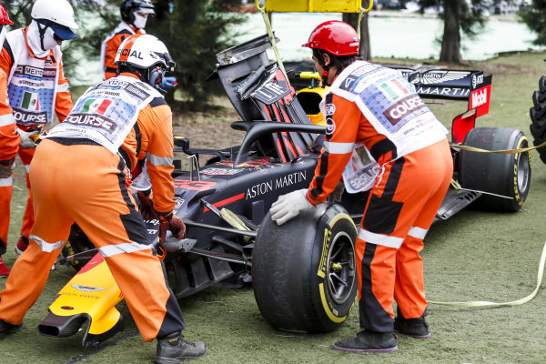 Car of Alexander Albon, Red Bull RB15 with Marshals after being crashed in FP2