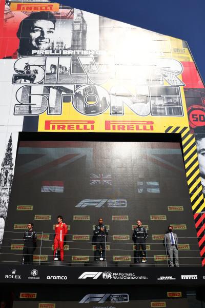 Sir Lewis Hamilton, Mercedes, on the podium with Charles Leclerc, Ferrari and Valtteri Bottas, Mercedes