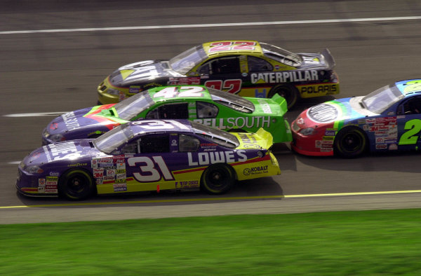 Second place finisher Mike Skinner leads Kenny Irwin (#42, 4th), Ward Burton (#22,10th) and eventual winner Jeff Gordon through the tri-oval in the closing laps of the race.NASCAR DieHard 500 at Talladega Superspeedway 16 April,2000 LAT PHOTOGRAPHIC-F Peirce Williams 2000