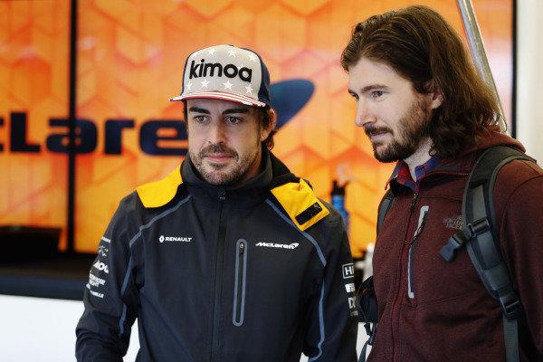 Fernando Alonso, McLaren, with IndyCar driver JR Hildebrand in the garage.