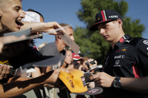 Max Verstappen, Red Bull Racing signs an autograph for a fan
