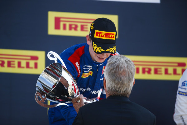 Robert Shwartzman (RUS) PREMA Racing, 1st, receives his trophy on the podium