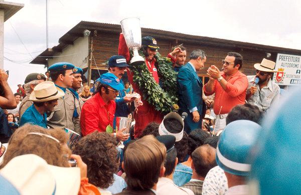 1974 Brazilian Grand Prix.Interlagos, Sao Paulo, Brazil.25-27 January 1974.Emerson Fittipaldi (McLaren Ford) 1st position, Clay Regazzoni (Ferrari) 2nd position and Jacky Ickx (Team Lotus) 3rd position on the podium.Ref-74 BRA 04.World Copyright - LAT Photographic