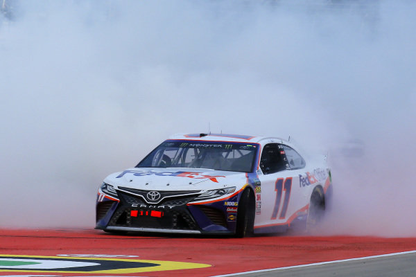 #11: Denny Hamlin, Joe Gibbs Racing, Toyota Camry FedEx Office celebrates his win with a burnout