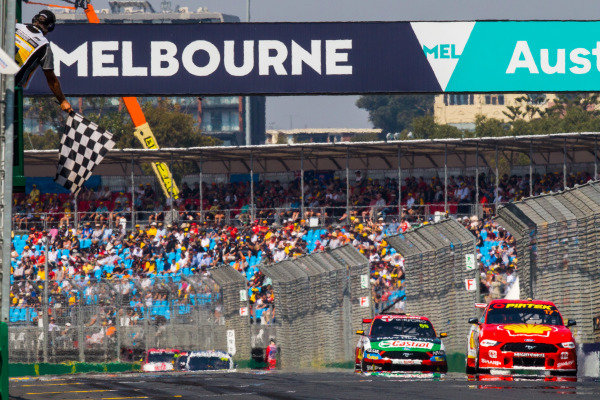 Scott McLaughlin, DJR Team Penske, Ford, takes the chequered flag from Anton de Pasquale, Erebus Motorsport, Holden