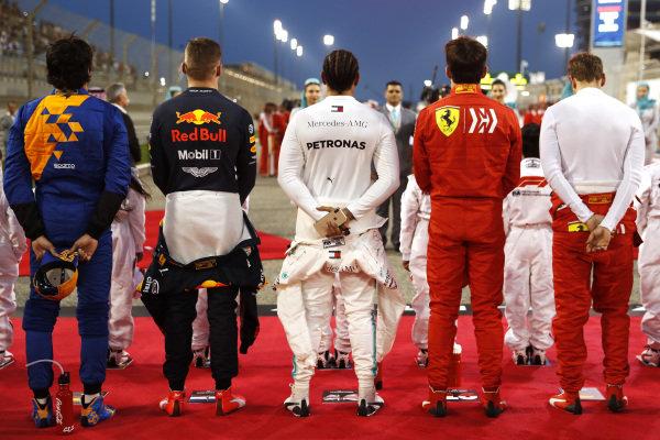 Carlos Sainz Jr, McLaren, Max Verstappen, Red Bull Racing, Lewis Hamilton, Mercedes AMG F1, Charles Leclerc, Ferrari, and Sebastian Vettel, Ferrari, on the grid for the national anthem