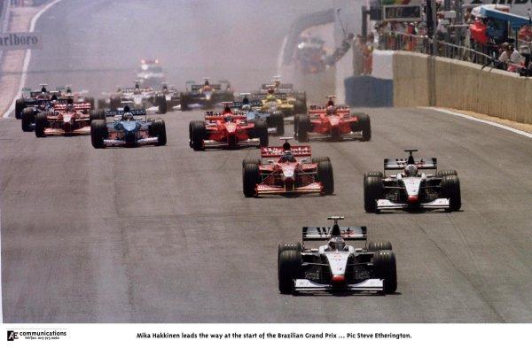 1998 Brazilian Grand Prix.Interlagos, Sao Paulo, Brazil.27-29 March 1998.Mika Hakkinen (McLaren MP4/13 Mercedes-Benz) leads the way at the start.World Copyright - Steve Etherington/LAT Photographic
