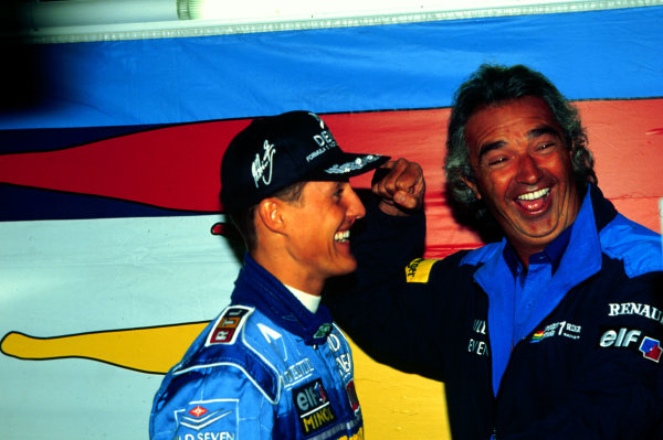 1995 Belgian Grand Prix.Spa-Francorchamps, Belgium.25-27 August 1995.Michael Schumacher celebrates with Benetton boss Flavio Briatore after winning.World Copyright - LAT Photographic