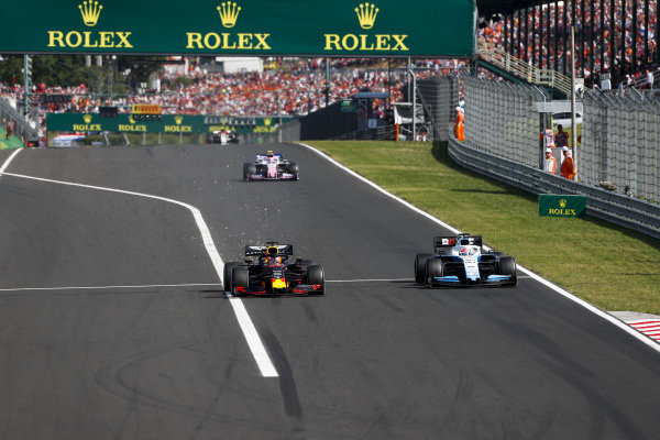 Max Verstappen, Red Bull Racing RB15, puts a lap on George Russell, Williams Racing FW42