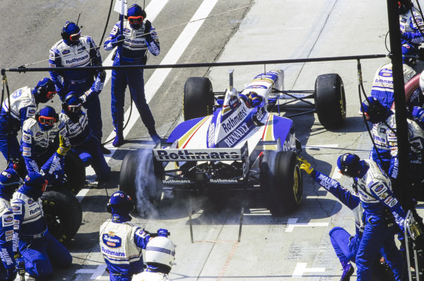 Jacques Villeneuve, Williams FW18 Renault, leaves his pit box after a stop.