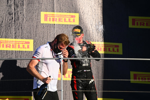 Nikita Mazepin (RUS, HITECH GRAND PRIX), sprays champagne on the podium