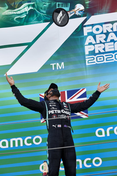 Lewis Hamilton, Mercedes-AMG Petronas F1, 1st position, tosses his trophy in the air in celebration on the podium