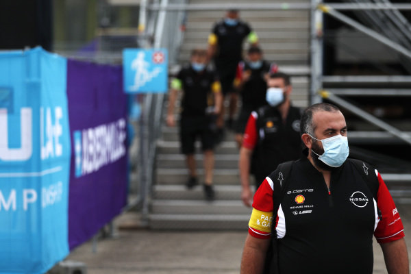 Nissan e.Dams team personnel arrive at the circuit