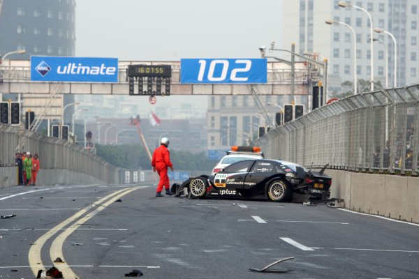 The wrecked car of Timo Scheider (GER), Audi Sport Team Abt after his crash.DTM, Rd11, Shanghai, China, 26-28 November 2010.World Copyright: LAT Photographicref: dne1027no42