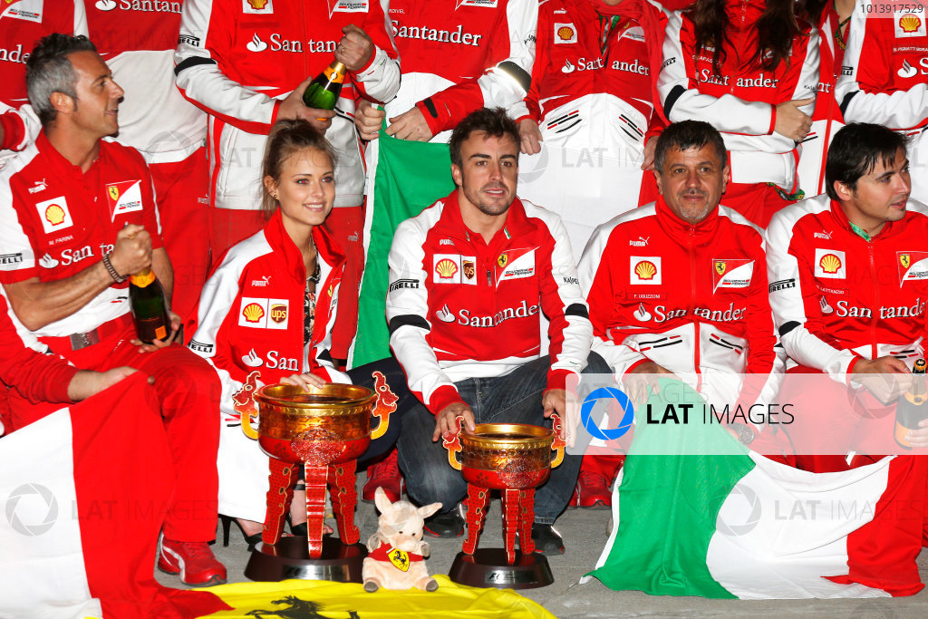 Shanghai International Circuit, Shanghai, China Sunday 14th April 2013 Fernando Alonso, Ferrari, 1st position, and the Ferrari team celebrate victory. World Copyright: Charles Coates/LAT Photographic ref: Digital Image _N7T7816