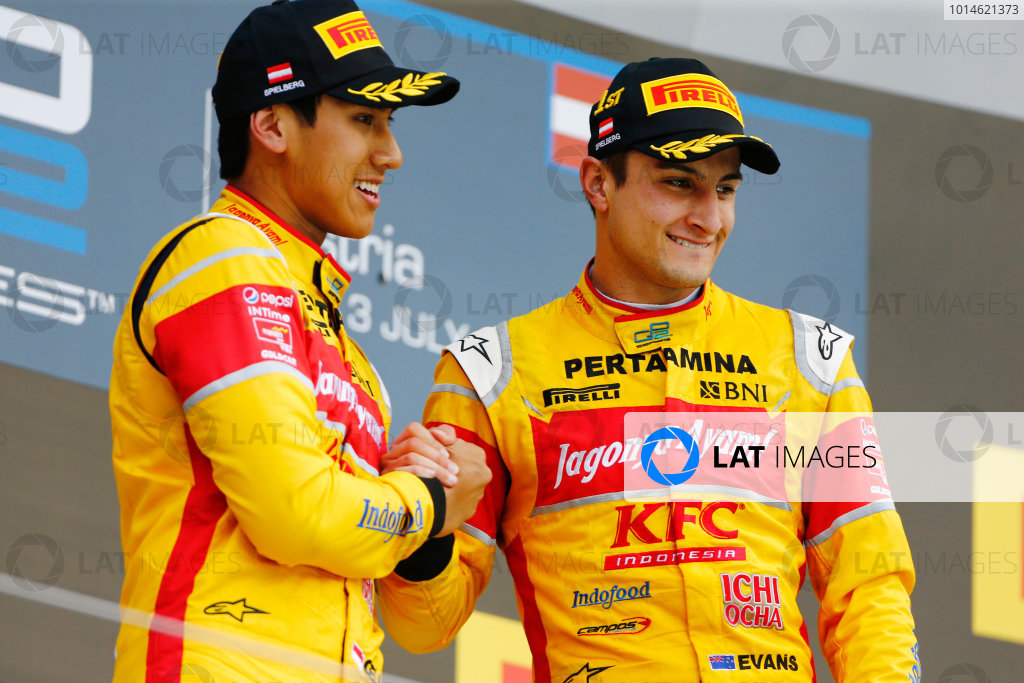 2016 GP2 Series Round 4 Red Bull Ring, Spielberg, Austria Saturday 2 July 2016 Mitch Evans (NZL, Pertamina Campos Racing) celebrates with Sean Gelael (INA, Pertamina Campos Racing) on the podium. Photo: Andrew Hone/GP2 Series Media Service ref: Digital Image _ONZ6056