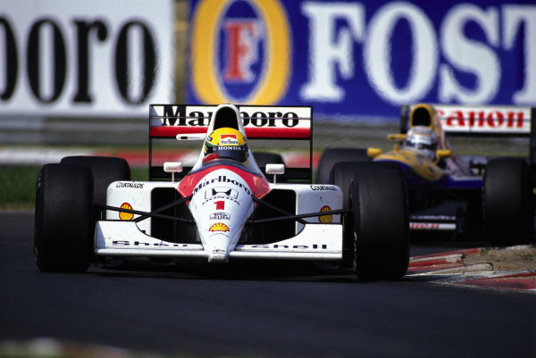 Ayrton Senna, McLaren MP4-6 Honda, leads Nigel Mansell, Williams FW14 Renault.