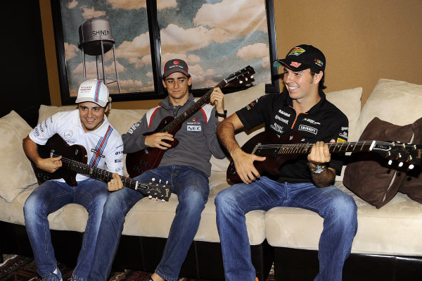 (L to R): Felipe Massa (BRA) Williams Martini Racing; Esteban Gutierrez (MEX) Sauber and Sergio Perez (MEX) Force India with their personalised Gibson Les Paul guitars. The event took place at the Austin Fans Forum in association with the Grand Prix Investors Fund that was held in the iconic Gibson Guitars showroom. Formula One World Championship, Rd17, United States Grand Prix, Preparations, Austin, Texas, USA, Wednesday 29 October 2014. BEST IMAGE