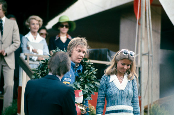 Monte Carlo, Monaco. 23 - 26 May 1974. Ronnie Peterson (Lotus 72E-Ford), 1st position, on the podium with his wife Barbro, portrait.  World Copyright: LAT Photographic. Ref: 74MON40