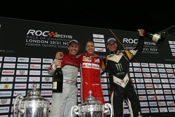 2015 Race Of Champions Olympic Stadium, London, UK Saturday 21 November 2015 Sebastian Vettel (GER), Petter Solberg (NOR) and Tom Kristensen (DMK), celebrate on the podium Copyright Free FOR EDITORIAL USE ONLY. Mandatory Credit: 'IMP'