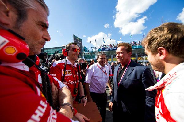 Albert Park, Melbourne, Australia. Sunday 20 March 2016. Sebastian Vettel, Ferrari, and Mauricio Arrivabene, Team Principal, Ferrari, meet Arnold Schwarzenegger on the grid. World Copyright: Zak Mauger/LAT Photographic ref: Digital Image _L0U8806