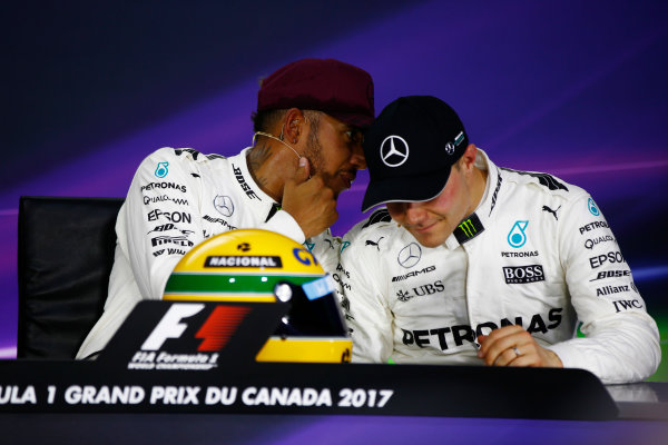 Circuit Gilles Villeneuve, Montreal, Canada. Saturday 10 June 2017. Lewis Hamilton, Mercedes AMG, shows off his Ayrton Senna helmet, a gift after equalling the Brazilian's pole record, alongside Valtteri Bottas, Mercedes AMG, in the post-qualifying press conference. World Copyright: Andy Hone/LAT Images ref: Digital Image _ONY4922