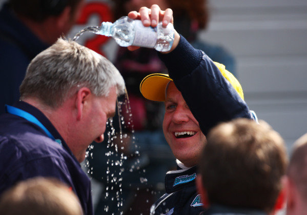 Brands Hatch, UK. 5th April 2009. Rds 1,2,3.  Rob Collard, Motorbase BMW, celebrates the team's first BTCC win by soaking Team Principle David Bartrum in parc ferme. Portrait.  World Copyright: Kevin Wood/LAT  Photographic Ref: Digital Image IMG_9029a