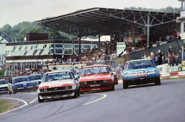 1982 British Saloon Car Championship. Brands Hatch, England. 16th - 18th July 1982. Rd 8. Vince Woodman (Ford Capri III 3.0S), 4th position, leads Gordon Spice (Ford Capri III 3.0S), 2nd position and Pete Lovet (Rover 3500 S), 1st position, at the start, action.  World Copyright: LAT Photographic. Ref:  Colour Transparency.