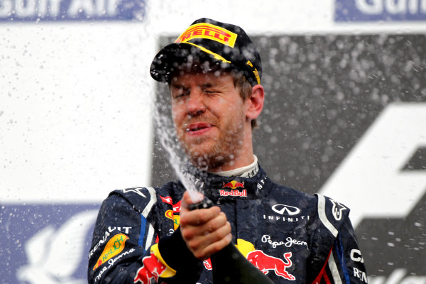 Bahrain International Circuit, Sakhir, Bahrain22nd April 2012Sebastian Vettel, Red Bull Racing, 1st position, sprays the Waard.World Copyright: Andy Hone/LAT Photographicref: Digital Image HONY8701