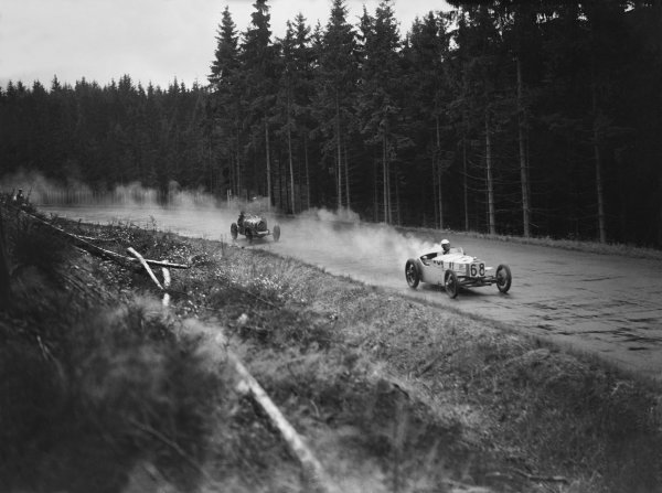 Nurburgring, Germany. 19th July 1931. Gerhard Macher (#68 DKW RWD), 6th position in Group 2, leads Jean-Pierre Wimille (#48 Bugatti T51), 8th position in Group 1, action.  World Copyright: LAT Photographic. Ref:  Autocar Glass Plate B6832
