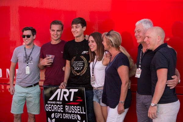 2017 GP3 Series Round 7.  Circuito de Jerez, Jerez, Spain. Sunday 8 October 2017. George Russell (GBR, ART Grand Prix) celebrates with his family and friends. Photo: Andrew Ferraro/GP3 Series Media Service. ref: Digital Image _FER3088