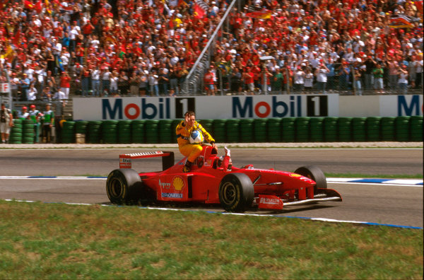 Hockenheim, Germany.25-27 July 1997.Michael Schumacher (Ferrari F310B) 2nd position, gives Giancarlo Fisichella a lift back to the pits aboard his car.Ref-97 GER 05.World Copyright - LAT Photographic