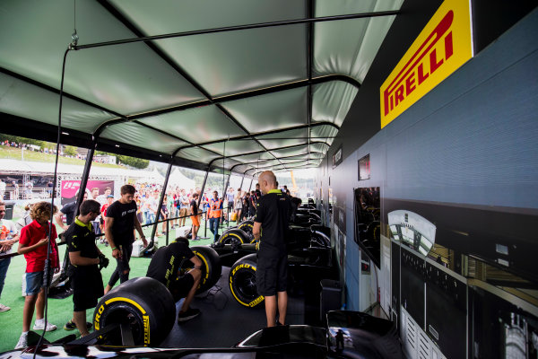 2017 FIA Formula 2 Round 5. Red Bull Ring, Spielberg, Austria. Saturday 8 July 2017. Campos and ART mechanics in the pit stop challenge in the fan zone. Photo: Zak Mauger/FIA Formula 2. ref: Digital Image _54I7711