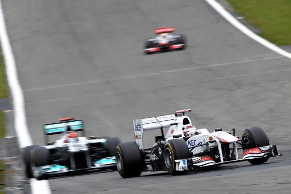 Nurburgring, Germany.24th July 2011Kamui Kobayashi, Sauber C30 Ferrari, 9th position, leads Michael Schumacher, Mercedes GP W02, 8th position. Action. World Copyright: Andy Hone/LAT Photographicref: Digital Image CSP13254