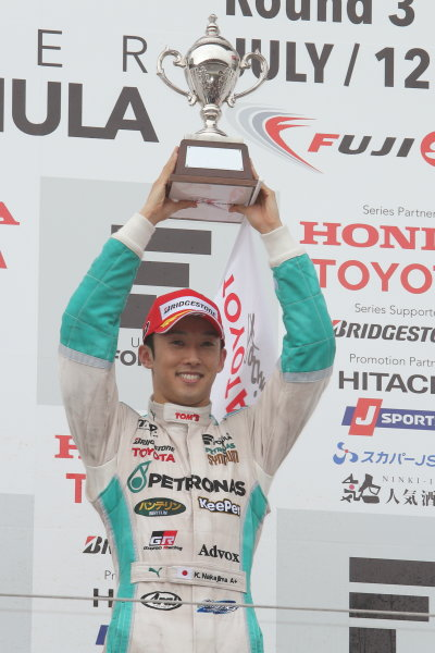 2014 Super Formula Series. Fuji, Japan. 11th - 13th July 2014. Rd 3. Winner Kazuki Nakajima ( #37 TEAM TOM'S SF14 ) podium, portrait. World Copyright: Yasushi Ishihara / LAT Photographic. Ref: 2014SF_Rd3_012.JPG